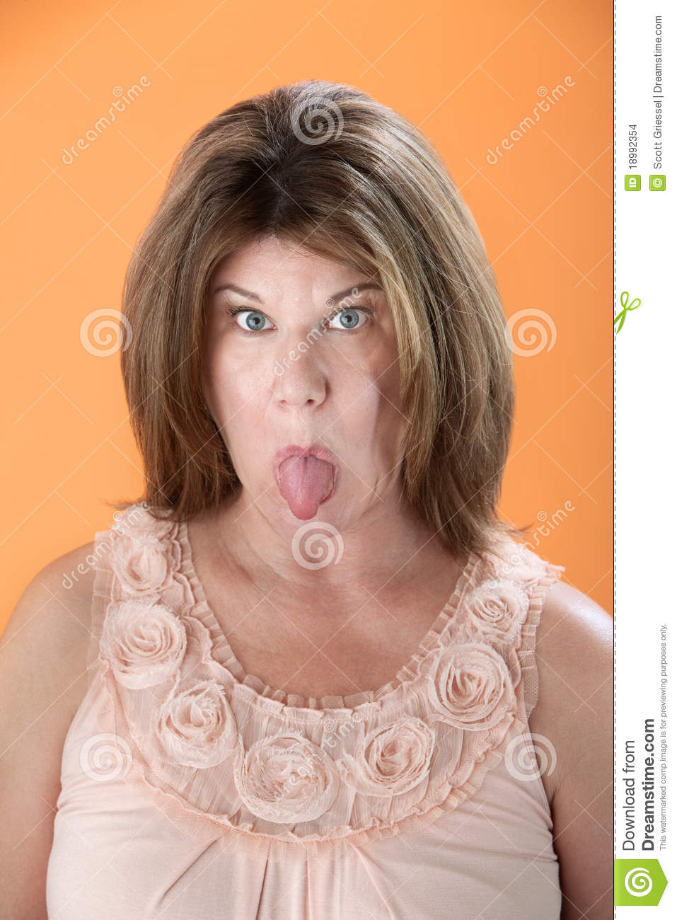 Mature sticking tongue out