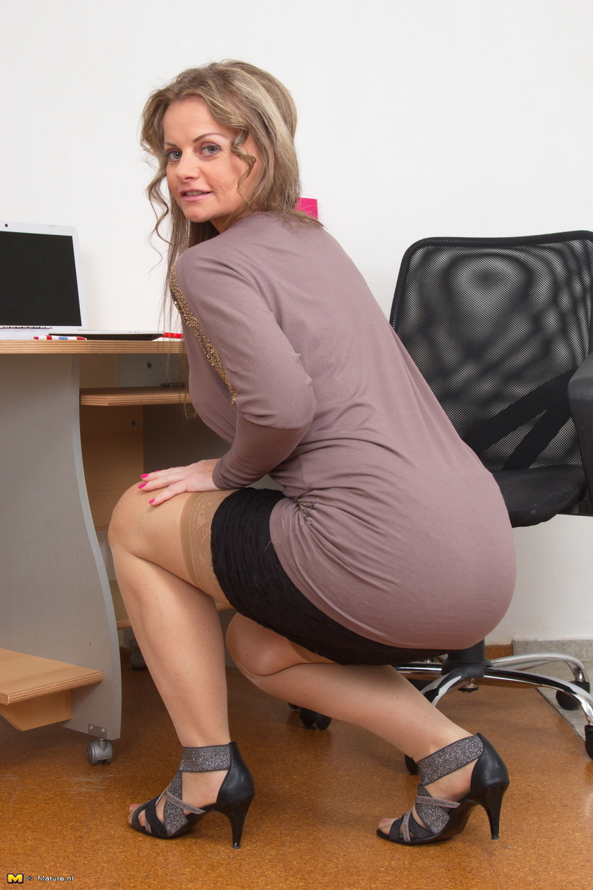 Naked mature office woman